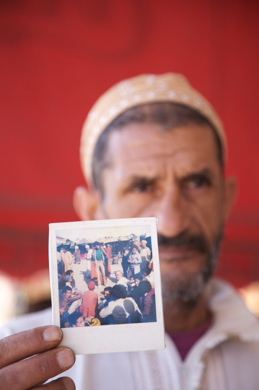 Abderrahim El Makkouri shows a photo of himself as a young storyteller